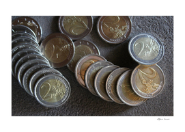Collection of 2 euro coins on the stone table