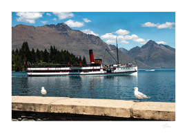 Queenstown waterfront with a steamship