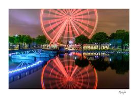 Reflection of illuminated La Grande Roue de Montreal