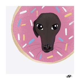 Cute Whippet Poking his Head Through A Pink Doughnut