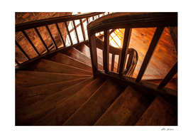 Wooden spiral staircase in old Poland castle.