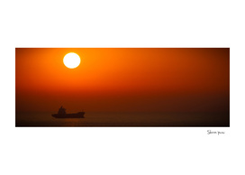 Orange Sunset over the Ocean with one ship