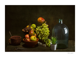 Still life with fruits and dishes on the table