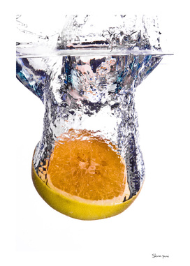 Grapefruit falls into water with big splash