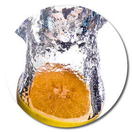Grapefruit falls into water with big splash