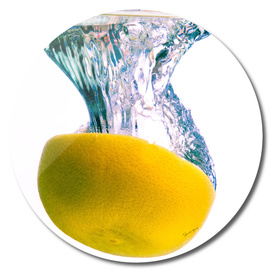 Grapefruit falls into water with big splash white background