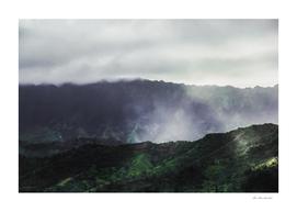 green tropical mountains with foggy sky at Kauai, Hawaii
