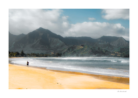 jogging at the beach with green mountain scenic Kauai