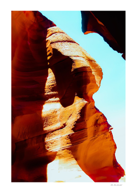 Orange sandstone abstract with blue sky at Antelope Canyon