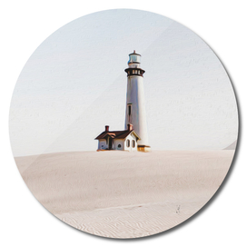 Lighthouse on the sandy shore.