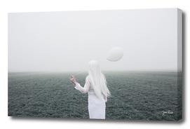 Girl and white balloon