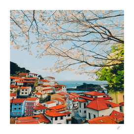 Blossoming cherry branches over the old town by the sea.