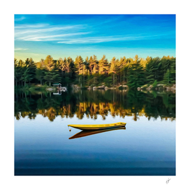 Yellow canoe on the lake by the forest.