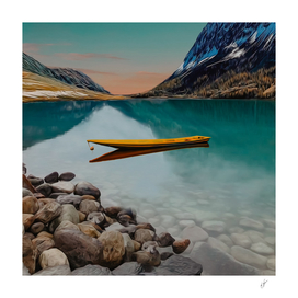 Yellow canoe on a lake in the mountains.