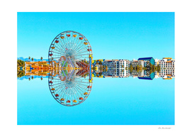 reflection of the ferris wheel with buildings and blue sky