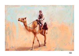 Man riding camel in the desert