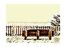 wooden bench and wooden fence at the beach