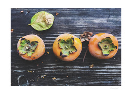 persimmons on the wooden table