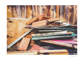 stack of wood with wooden fence background