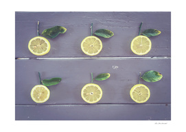 fresh lemon with green leaf on the wooden table