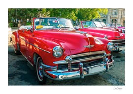 Beautiful red classical cars used as taxis in Havana, Cuba