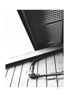 wood building in the city in black and white