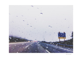 on the road with the rain storm