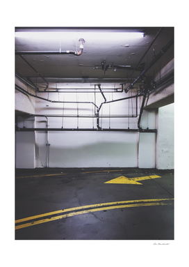 parking lot with the yellow arrow and tubes