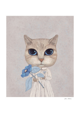 A Cat With A Blue Flower