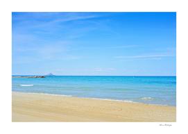 Sandy beach and blue Mediterranean sea