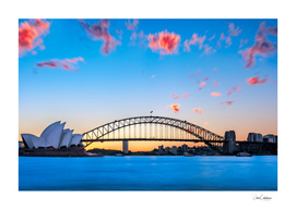 Sunset behind Opera House and Sydney Harbour Bridge