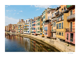 Colorful houses and reflected in water in Girona