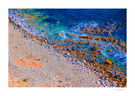 blue water at the ocean with rock and stone in summer