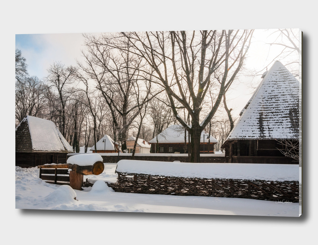 Traditional homestead covered in snow