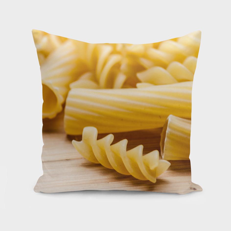 Italian pasta on a wooden table