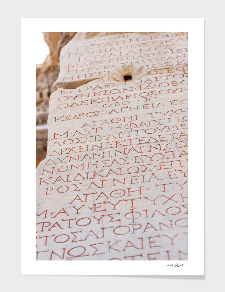Greek writes on the marble stones of the library of Celsus
