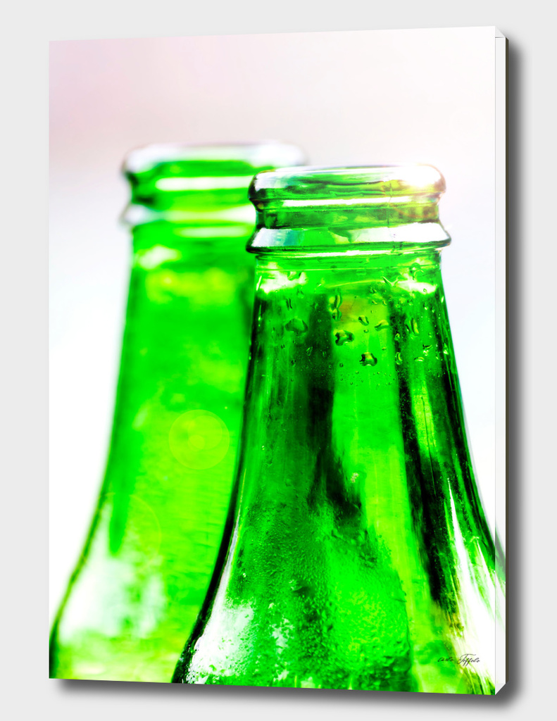 Two green bottles of fresh water