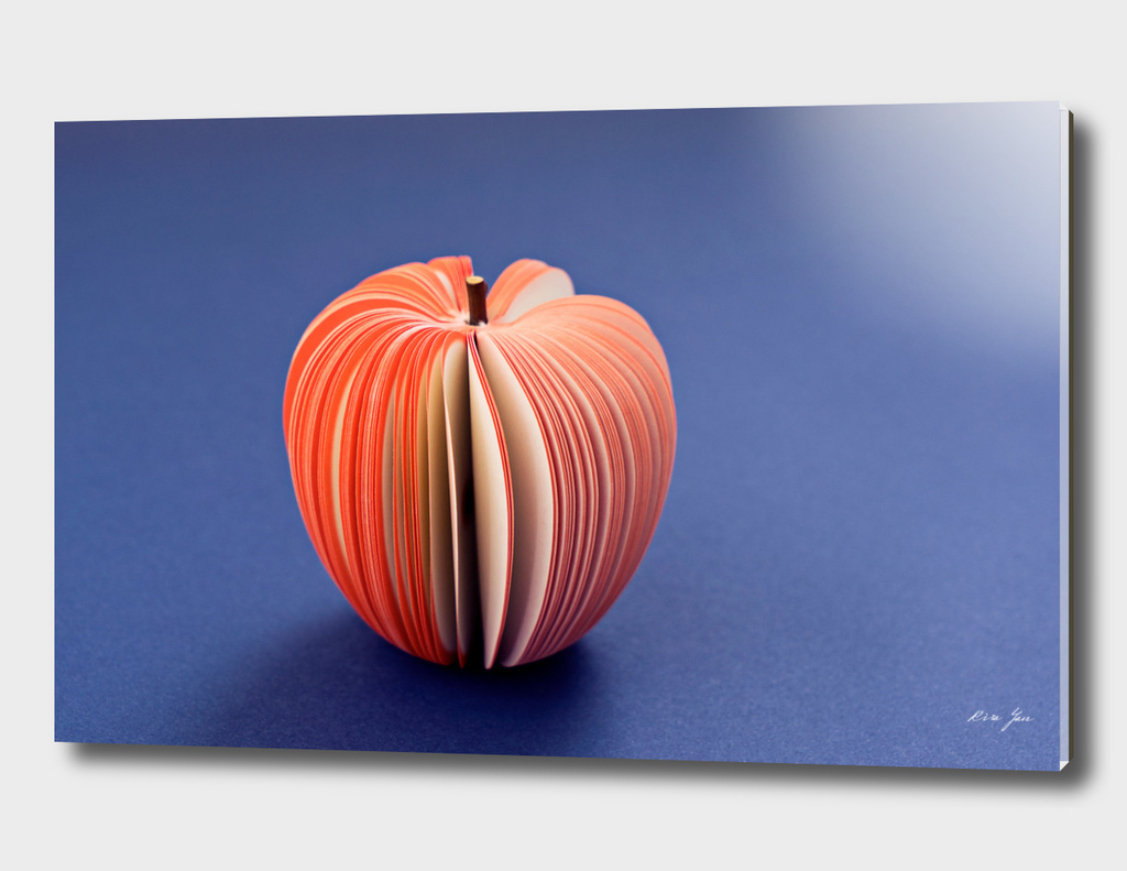 Fake Apple from paper on the purple violet background