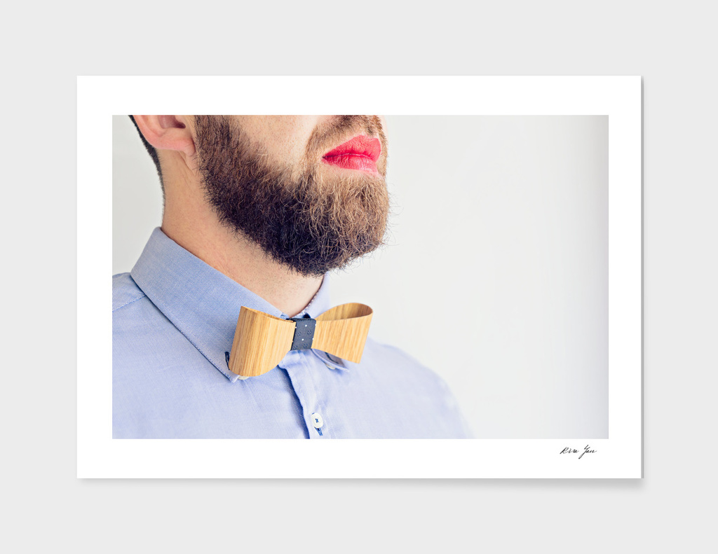 Adult bearded Man with Red Lipstick on Lips