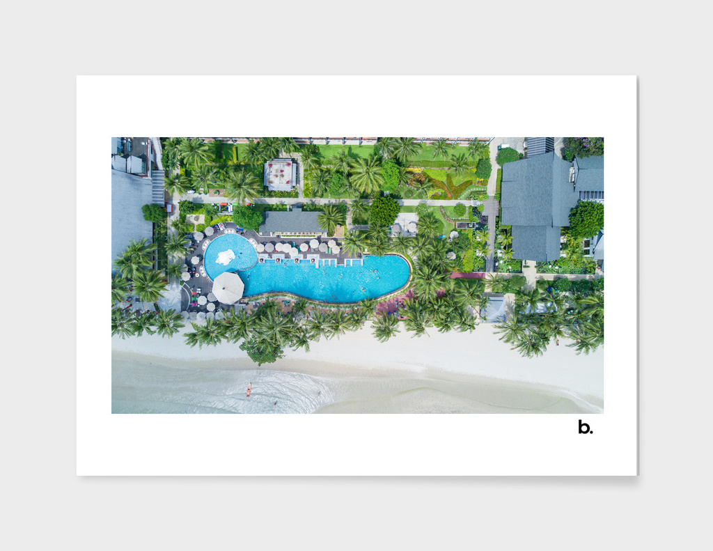 Tropical Landscape. The Sea, Palms And Pool. Aerial View.