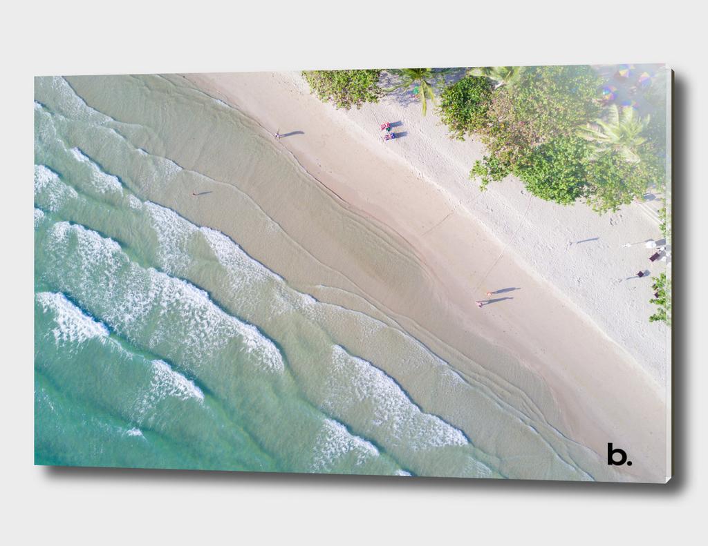 Fly over the Tropical Island Beach. Ocean waves.