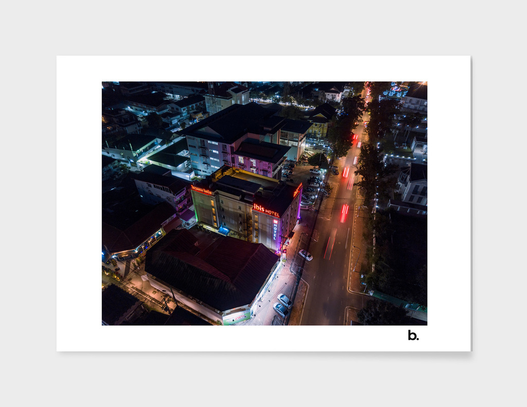Hotel by Night. Aerial Top view of the Night City.