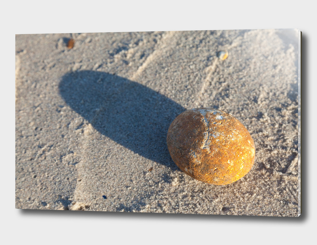 Stone and shadow at the beach