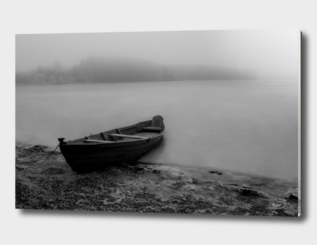 Boat On The Shore Near Frozen Lake