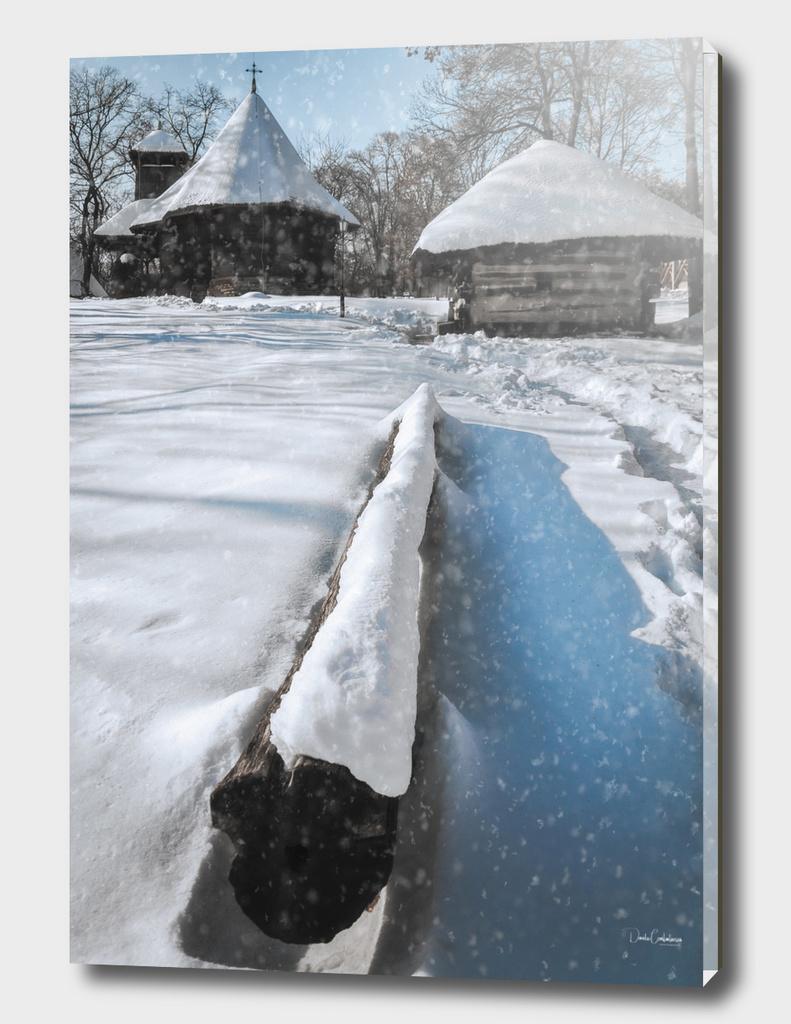 Heavy snow cover in a Romanian village in winter