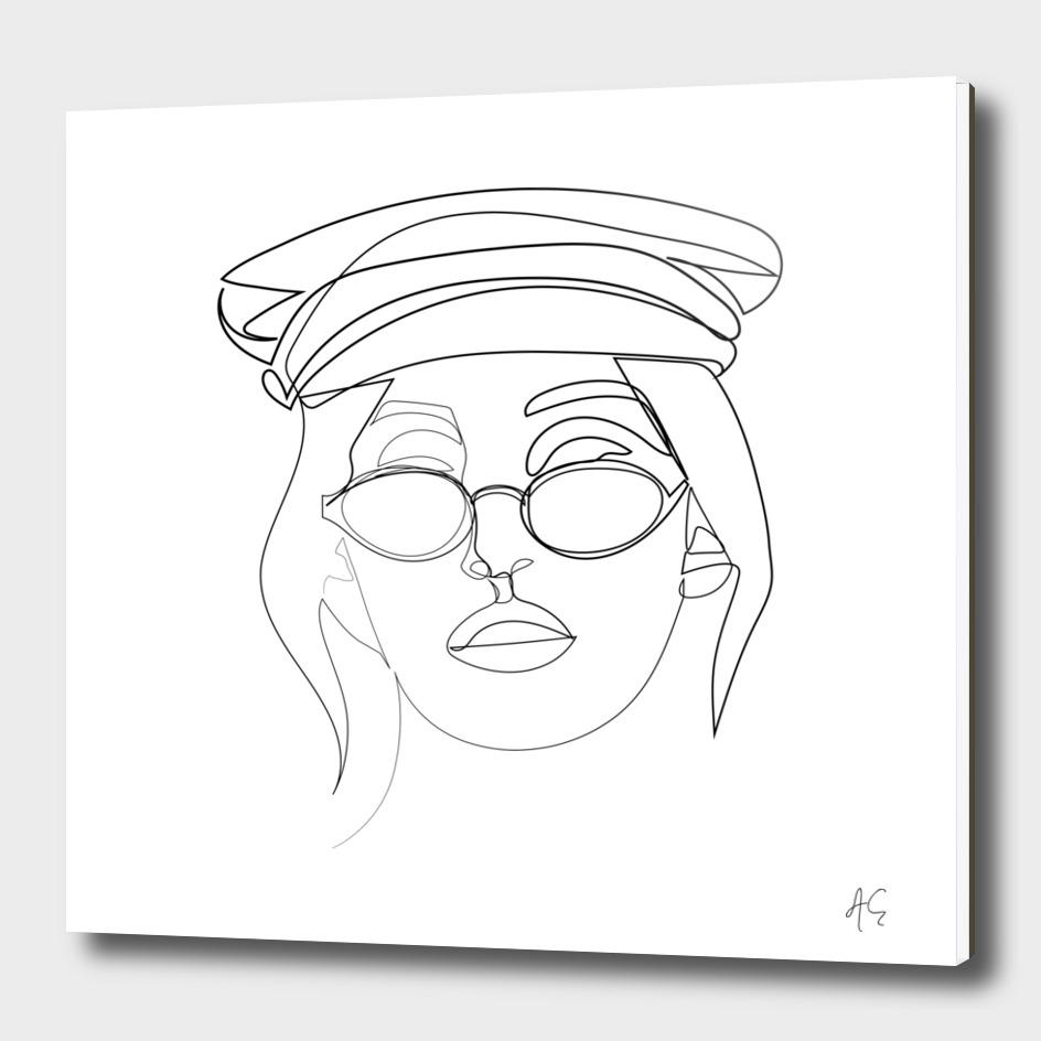 Woman Wearing Sunglasses And Nautical Hat