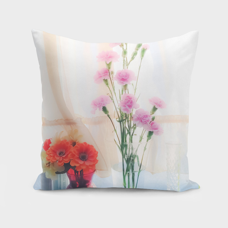 pink flowers and orange flowers with white curtain