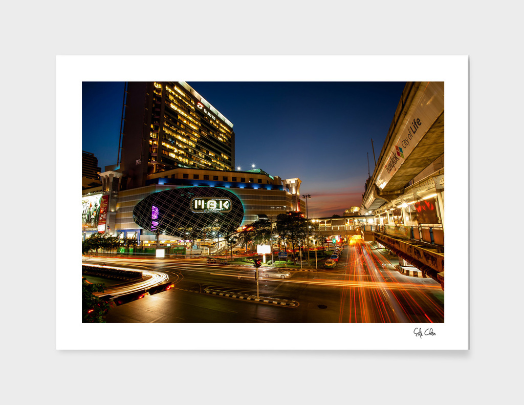 MBK Center with traffic at sunset, BANGKOK, THAILAND