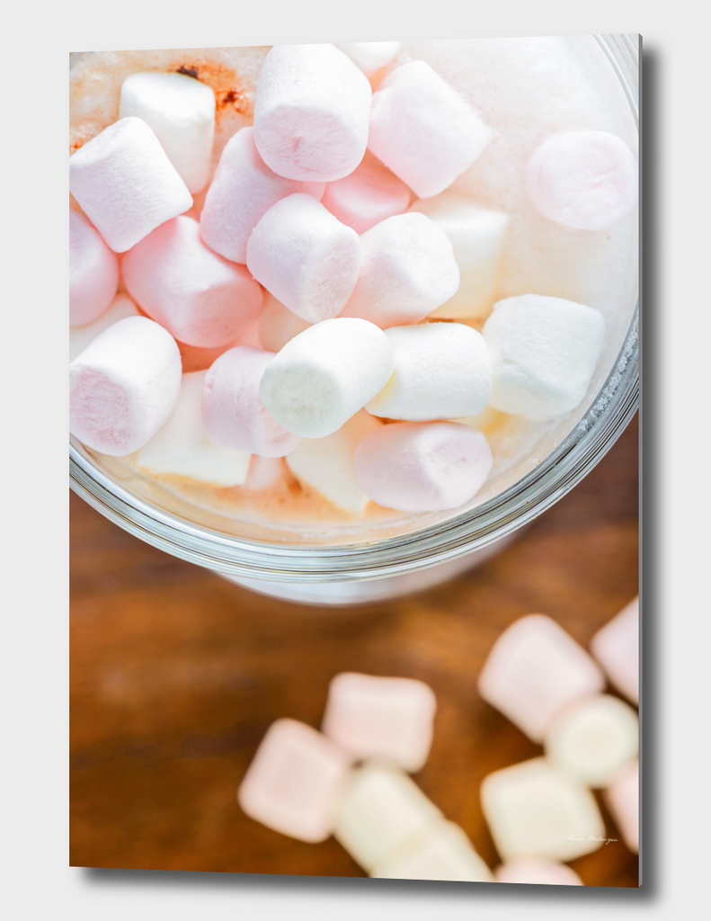 Top view to the  marshmallows in hot chocolate  in the glass