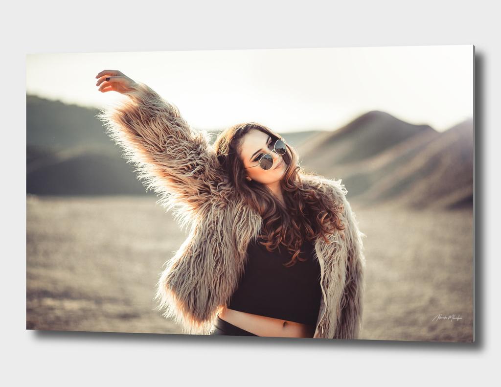 Fashion portrait of Beautiful young girl in desert